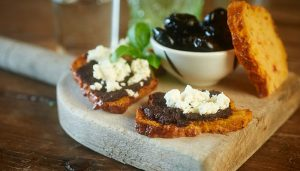 Sundried tomato and basil Tartine topped with Black Olive Tapenade and crumbled Feta